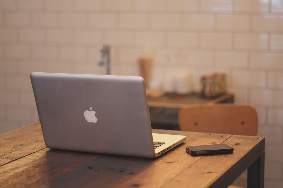 Apple laptop on a table