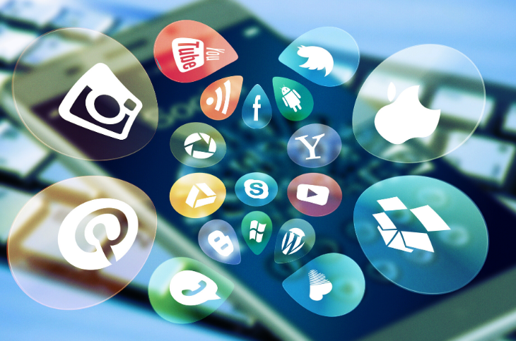 Social media icons over a smart phone